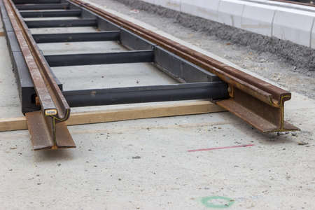 rail cross: Cross section of the new profile tram rail. Selective focus.
