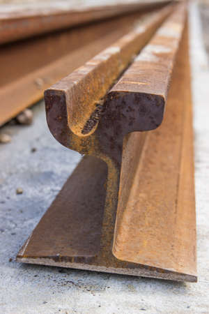 steel rusty tram rail profile, ready to be installed Stock Photo