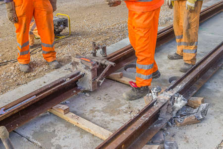 Tram tracks recently joined, welded joint. Thermit welding process. photo