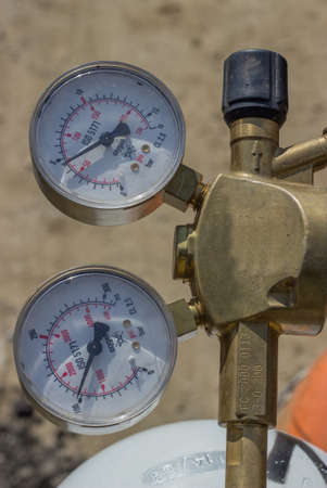 regulator: Dual pressure gauges of oxy acetylene tanks, pressure regulator