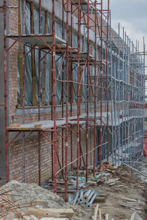 safety equipment: Scaffolding on building. Building covered in scaffolding at construction site. Astract: construction industry. Stock Photo