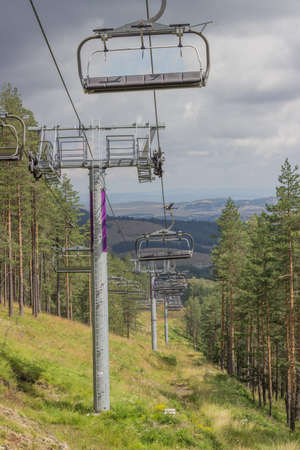 Ski lift on on the top of mountain in summer