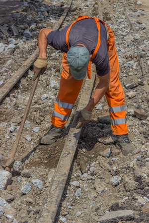 reconstruction: works on the of reconstruction tram tracks. Selective focus. Stock Photo