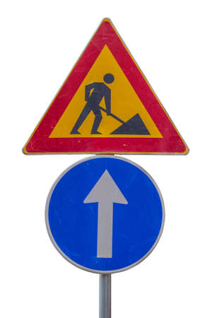 Traffic sign for construction works in street and blue direction sign on white background with clipping path Imagens