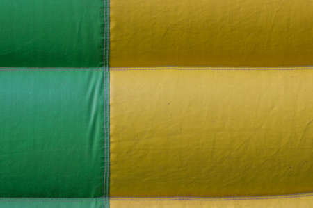 tarpaulin: green yellow PVC tarpaulin detail background, material on inflatable jumping castle