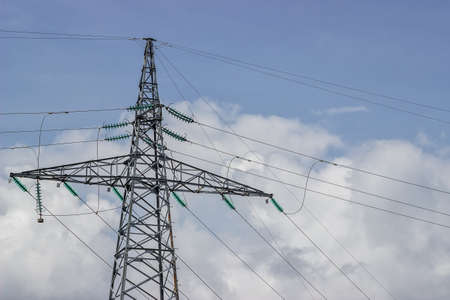 utility pole: Electricity pylon supporting wires for electrical power distribution. Utility pole with lot of wires.