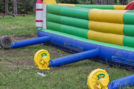 blowers: Inflatable fan blowers on bouncy castle, air blowers. Selective focus. Stock Photo