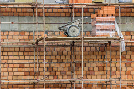 hollow wall: Construction site with hollow clay block wall and scaffolding