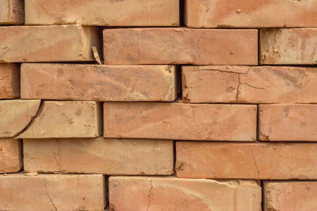 clay brick: Stacked orange solid clay brick for building construction background. Stock Photo
