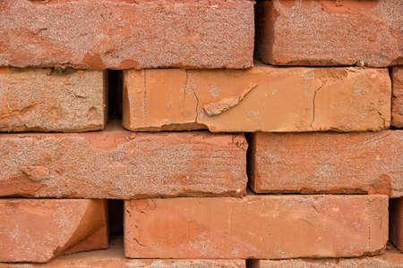 solid: Stacked orange solid clay brick for building construction background. Stock Photo