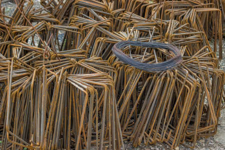 annealed: Black Annealed Iron Wire on heap of steel reinforcement bars. Selective focus. Stock Photo