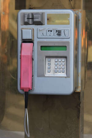 pay phone: Old style public pay phone at street. Public phone box. Stock Photo
