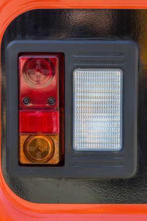taillight: Vehicle rear lamp closeup. Taillight on the vehicle. Stock Photo