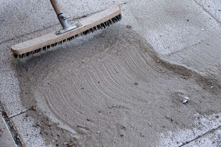 brooming: Install polymeric sand by brooming it into the paver joints during construction works