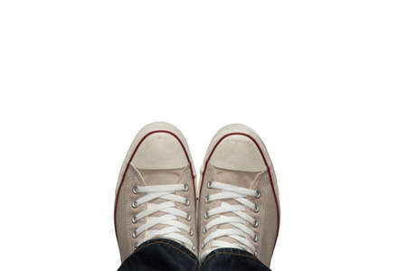 Feet in sneakers from above. isolated on white background. and made with selective focus. Standard-Bild
