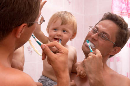 tooth brush: The father learns the son to clean teeth
