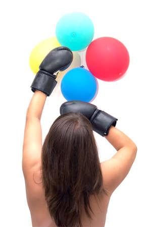 woman the boxer puts impact on an air ball photo