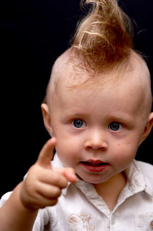 topknot: Portrait of the boy showing by a finger of a hand