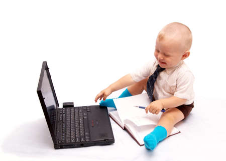 The small businessman works on the computer, on a white background photo