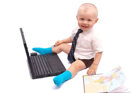 The small businessman with the computer on a white background photo