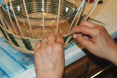 dexterity: dexterity is one of the primary qualities of practicing basketry Stock Photo