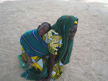 african village: african woman and her baby