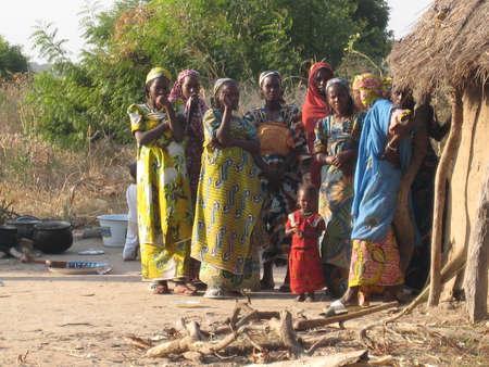 african village: African women and children