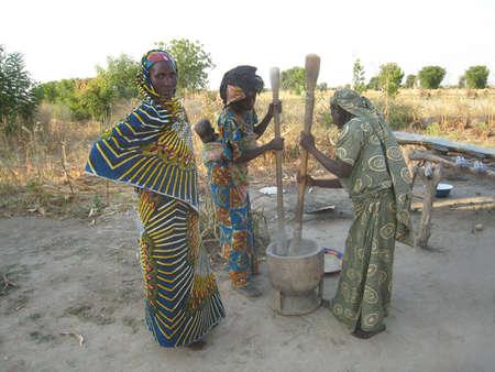 cameroon: women crushing floor in a mortar in Cameroon