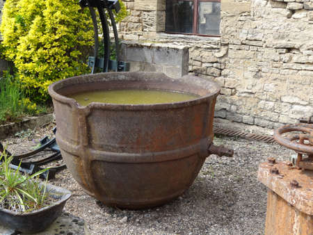 caldron: rusty metal pot in an old foundry