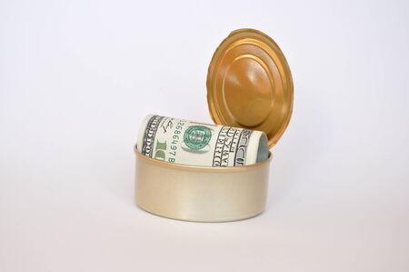 tin can: Tin can full of dollar bills