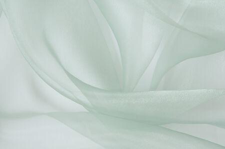 the background of light transparent silk Фото со стока