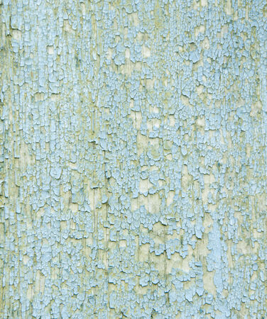 hued: Old wooden wall with cracked blue paint