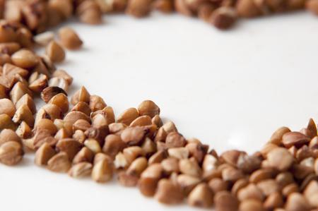 buckwheat on the white background close up
