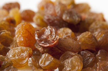 raisins on the white background close up