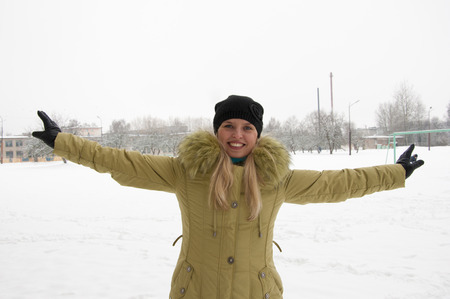 happy young woman on the winter background