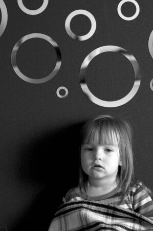 portrait of little sad girl black and white