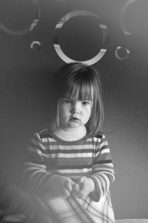 portrait of a little girl in the haze