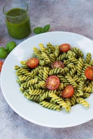traditional Italian dish. vegetarian pasta with green Basil pesto, Parmesan and pine nuts. 写真素材