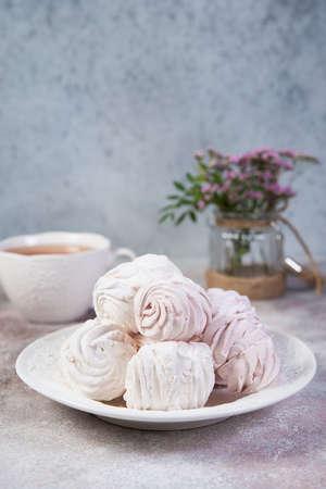 Apple zephyr on a plate for tea