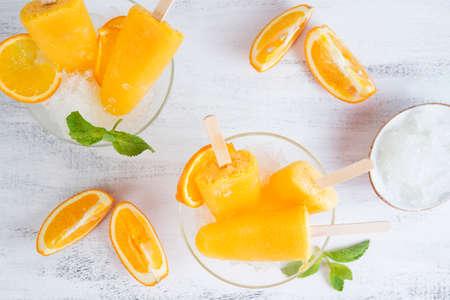 Frozen orange ice on a stick. Vegan dessert.