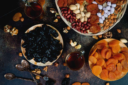 Traditional Arabic tea with dried fruits , nuts and tea, top view Archivio Fotografico