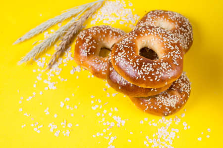 Creative layout of bagels on a bright yellow background, food concept 版權商用圖片