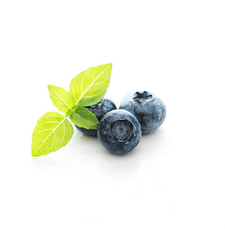 Fresh summer blueberry in water drops isolated on a white background Standard-Bild