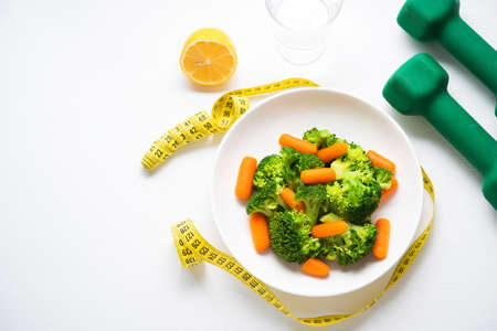 A plate of diet food, boiled vegetables, broccoli and carrots, fitness nutrition, selective focuse 版權商用圖片