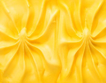 Natural mango ice cream close-up. Mango ice cream background. Top view