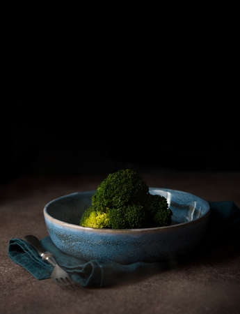 Boiled broccoli in a plate on a black background with a copy of space 版權商用圖片