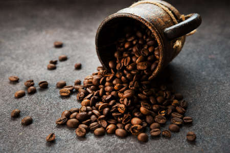 Roasted coffee beans on a dark background, close-up, selective focus