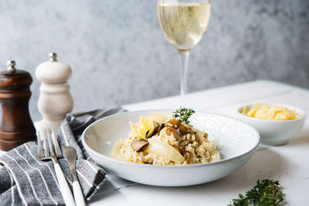 Risotto with porcini mushrooms and parmesan on a light background, selective focus 版權商用圖片