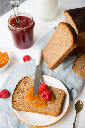 Fresh homemade bread with jam and milk, homemade simple food