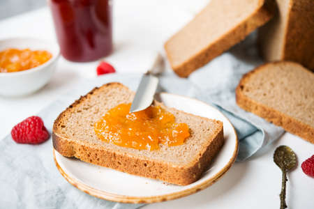Fresh homemade bread with jam and milk, homemade simple food, selective focuse